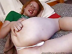 Redhead In Glasses Shoves A Vibrator Up Her Ass