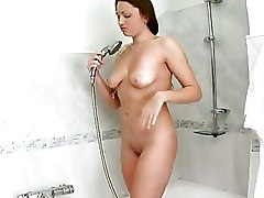Naughty Nubile Cleans Her Horny Pussy In The Showe