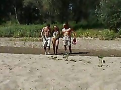Busty Brunette With Shaved Pussy Fucks On Sandy Beach With Two Men