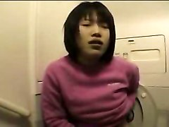 Asian Girl Masturbates In Airplane Bathroom