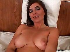 Big Titty Brunette Giving A Handjob