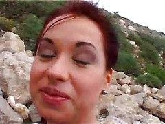 Olga Smokes And Strips On The Rocks