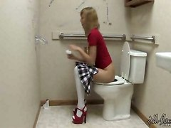 Blonde Teen Does It In Public Toilet!