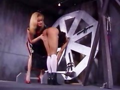 Spanking Session On A Wheel